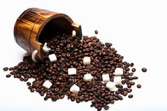 Coffee beans on wooden cask. Coffee beans, wooden cask and sugar cubes on white background. Side view Stock Image