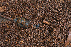 Coffee beans. And a wooden figure of the Indian Stock Photo