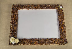 Coffee beans on a wooden frame. Empty space for your text Stock Images