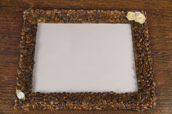 Coffee beans on a wooden frame. Empty space for your text Stock Photography