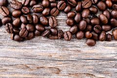 Coffee beans on wooden ground Stock Images