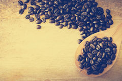 Coffee beans on a wooden ladle Stock Photography