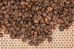 Coffee beans on wooden mat Stock Image
