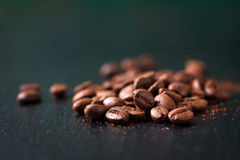 Coffee beans on a wooden old green background Stock Photo
