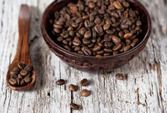 Coffee beans in the wooden plate Stock Photos