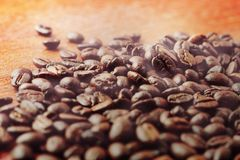 Coffee beans on wooden. Royalty Free Stock Photos