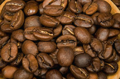 Coffee beans on wooden saucer Stock Photography