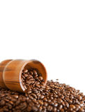 Coffee beans with wooden scoop Royalty Free Stock Images