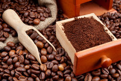 Coffee beans with wooden scoop Stock Images