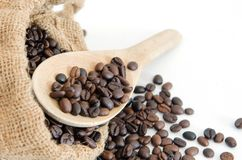 Coffee beans with wooden scoop Royalty Free Stock Photo