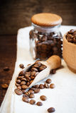 Coffee beans in wooden scoop Royalty Free Stock Photo