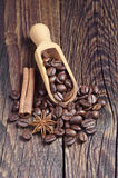 Coffee beans and wooden scoop Stock Photos