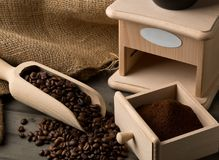 Coffee beans in wooden scoop and ground coffee with coffee bean Stock Photos