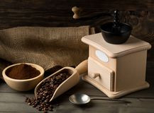 Coffee beans in wooden scoop and ground coffee with coffee bean Royalty Free Stock Photography