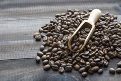 Coffee beans with wooden scoop Stock Photos