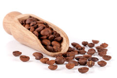 Coffee beans in a wooden scoop  on white background.  Royalty Free Stock Images
