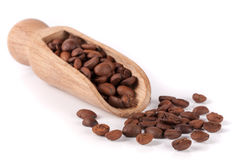 Coffee beans in a wooden scoop  on white background.  Stock Photography