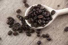 Coffee beans on wooden spoon Stock Photos