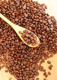 Coffee beans and wooden spoon.  Stock Image