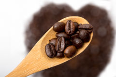 Coffee beans. In wooden spoon Stock Images