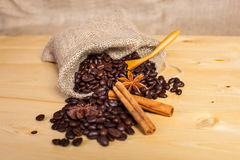 Coffee beans with a wooden spoon stock photos