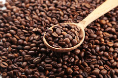 Coffee beans in wooden spoon, close up Stock Photos