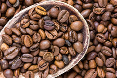 Coffee beans in wooden spoon Royalty Free Stock Images