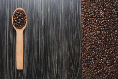 Coffee Beans in wooden spoon. Copy space image of coffee Beans in wooden spoon Royalty Free Stock Photo