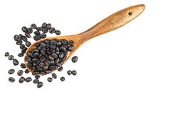Coffee beans in wooden spoon isolated on white Royalty Free Stock Photography