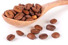 Coffee beans in a wooden spoon isolated on a white background.  Royalty Free Stock Photo