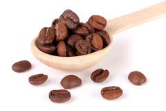 Coffee beans in a wooden spoon isolated on a white background.  Stock Photography