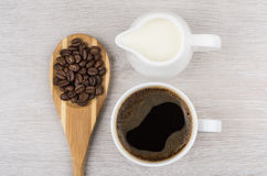 Coffee beans in wooden spoon, milk and cup of espresso Stock Photography