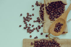 Coffee beans and wooden spoon on sack surface.Filter effect retr Royalty Free Stock Photos