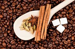 Coffee beans. And wooden spoon with spice and lump sugar Royalty Free Stock Photo