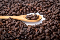 Coffee beans. In wooden spoon  ,surrounding with Royalty Free Stock Image