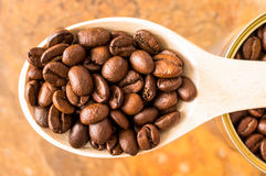 Coffee beans in a wooden spoon top view Royalty Free Stock Images
