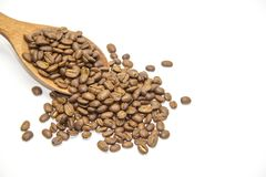 Coffee beans in wooden spoon on white background.  Royalty Free Stock Images