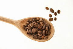 Coffee beans in a wooden spoon Royalty Free Stock Photos