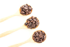 Coffee Beans in wooden spoon on white background. Coffee Beans in wooden spoon on a white background Stock Photography