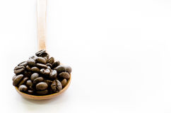 Coffee beans in wooden spoon on white background, Coffee, Aroma Stock Image