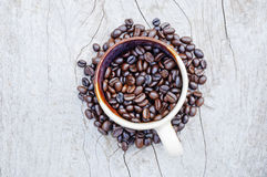 Coffee beans. On wooden surface Royalty Free Stock Photography