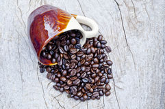 Coffee beans. On wooden surface Royalty Free Stock Images