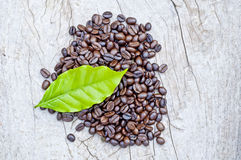 Coffee beans. On wooden surface Stock Photos