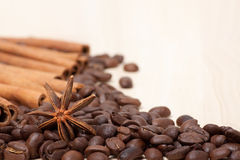 Coffee beans on wooden surface Stock Photos