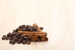 Coffee beans on wooden surface Royalty Free Stock Photo
