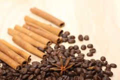 Coffee beans on wooden surface Stock Images