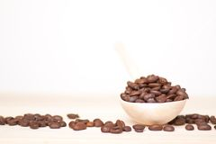 Coffee beans on wooden surface Stock Photography