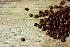 Coffee beans on wooden surface. Royalty Free Stock Photo