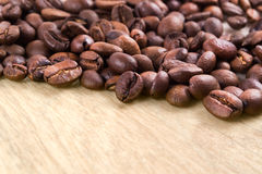 Coffee beans. On a wooden table Royalty Free Stock Image