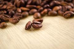 Coffee beans. On a wooden table Royalty Free Stock Photos